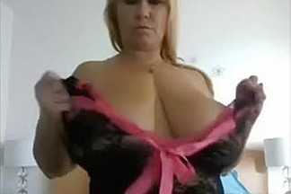 Voluptuous blonde mother I'd like to fuck with moist boobies poses on cam