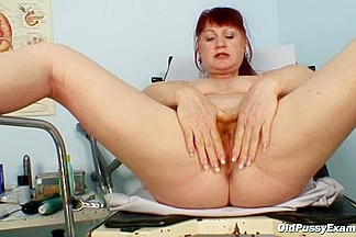 Mature Olga has her redhead pussy gyno speculum examined