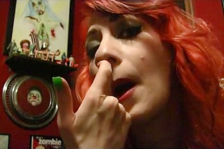Redhead nose picking booger queen