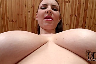 Karina Heart pouring oil on her boobs and massaging them hard