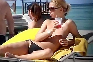Barefaced Russian blondie likes to tan her body topless