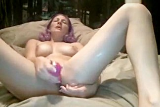 RaeRiley fucks herself on the bed