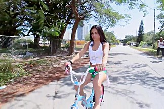 Booty college girl on a bicycle