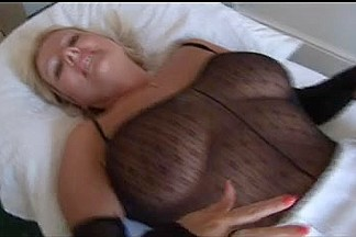 Big Tits Mature in Catsuit