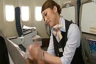 Asain Flight Attendant with long nails gives a HJ