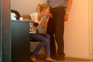 Blonde blows boss cock in the office