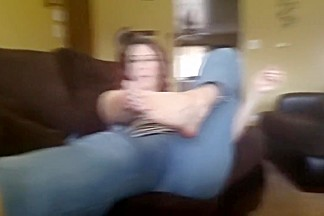 Josie gives a handjob and footjob on the couch