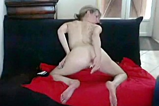 Milf makes a sextape with her husband on the sofa