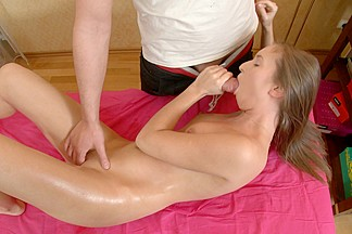 Hot angel masturbated in massage table and sucks strapon untill cock juice