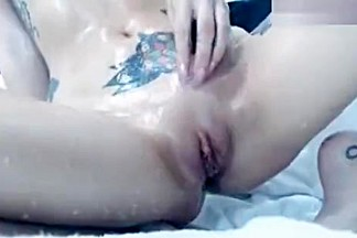 Brunette PetiteMarie playing with ice cubes