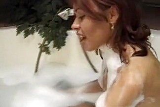 Latina gets fingered and fucked in the bath.
