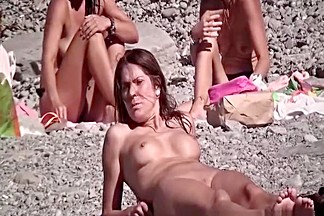 Nude man and woman at nudist beach